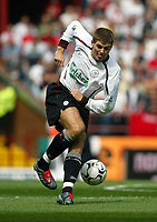 Photograph: Scott Heavey.<br />Aston Villa V Liverpool. FA Barclaycard Premiership match from Villa Park. 24/08/2003.<br />Steven Gerrard turns in midfield.