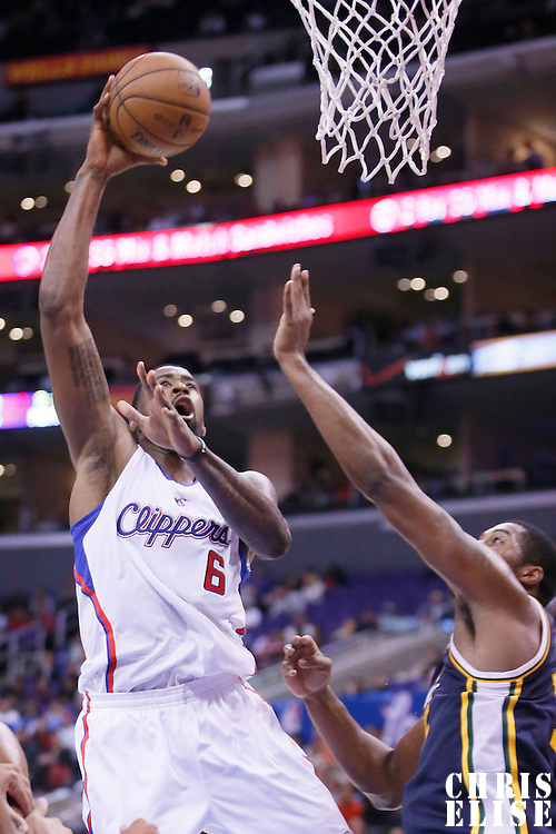23 October 2013: Los Angeles Clippers center DeAndre Jordan (6) goes for the skyhook over Utah Jazz power forward Derrick Favors (15) during the Los Angeles Clippers 103-99 victory over the Utah Jazz at the Staples Center, Los Angeles, California, USA.