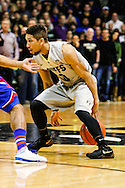 December 7th, 2013:  Colorado Buffaloes junior guard Askia Booker (0) dribbles the ball behind his back during the first half of action in the NCAA Basketball game between the Kansas Jayhawks and the University of Colorado Buffaloes at the Coors Events Center in Boulder, Colorado