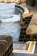 breaking wave on sea wall at Point Lonsdale Front Beach