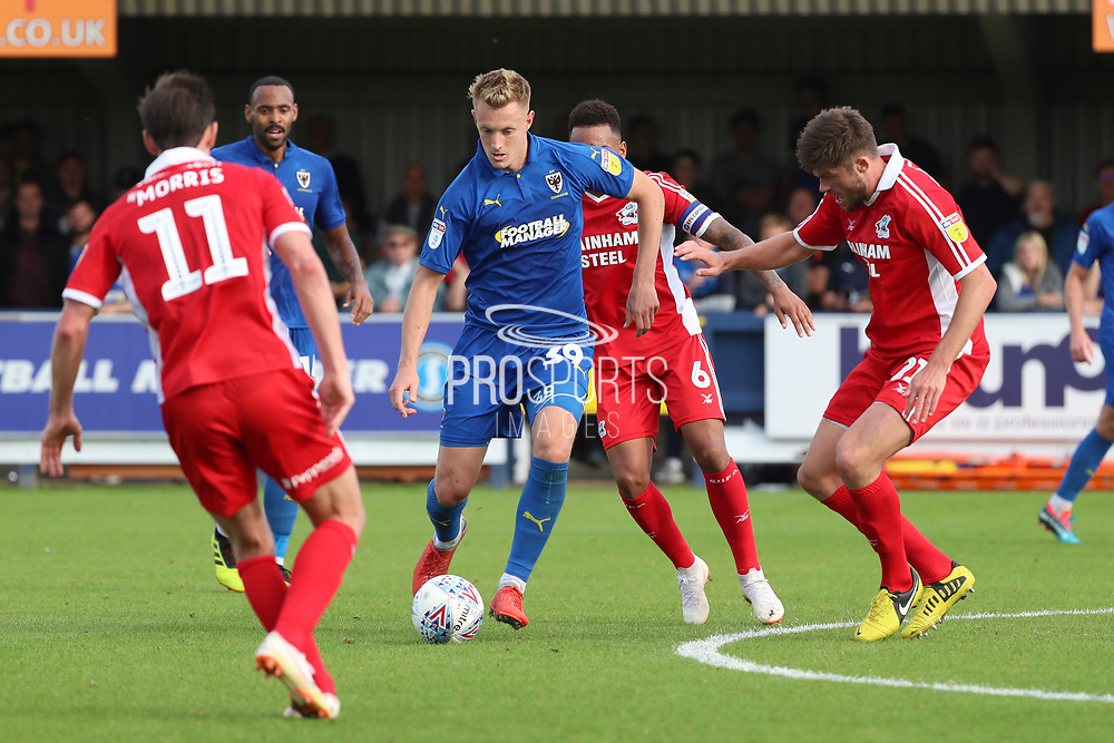 AFC Wimbledon striker Joe Pigott (39) dribbling during the EFL Sky Bet League 1 match between AFC Wimbledon and Scunthorpe United at the Cherry Red Records Stadium, Kingston, England on 15 September 2018.