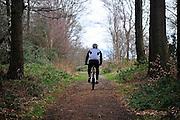Nederland, Vaals, 8-2-2014Een man op een mountainbike rijdt in het bos.Foto: Flip Franssen/Hollandse Hoogte