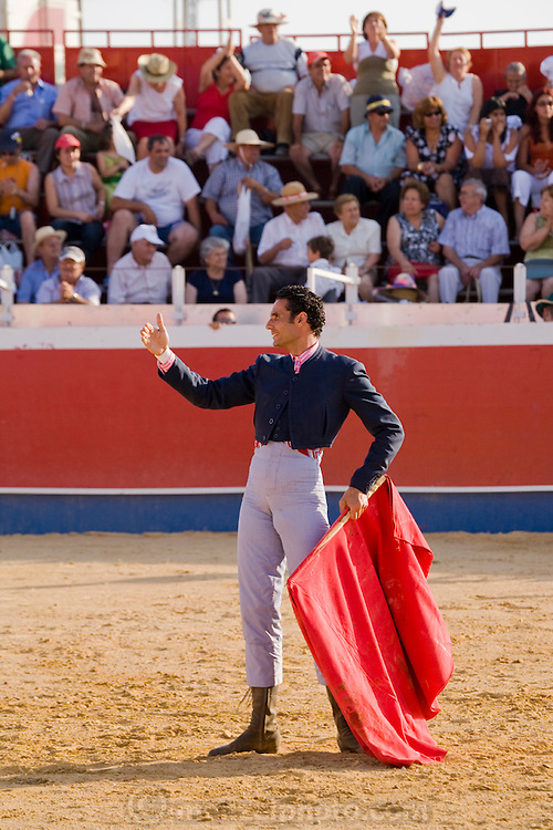 Professional bullfighter Oscar Higares pauses for a moment as fans stand up to catch a better glimpse of his performance at the annual village festival of San Juan in Campos del Rio, near Murcia in southern Spain. (Oscar Higares is featured in the book What I Eat: Around the World in 80 Diets.) MODEL RELEASED.
