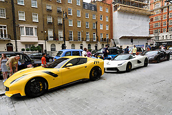 © Licensed to London News Pictures. 25/08/2016.  A fleet of supercars including a Ferrari F12TDF, a Ferrari Le Farrari and a Bugatti Veyrom car is parked in Knightsbridge.  The cars are believed to be owned by Quatar Sheikh Khalifa bin Hamad bin Khalifa Al-Thani otherwise know as KHK. London, UK. Photo credit: Ray Tang/LNP