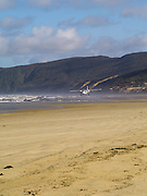 A puddle jumper airplane delivers hikers and trampers to the beach at Mason Bay, Stewart Island (Rakiura) after a short flight from Invercargill, New Zealand
