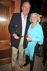 LIBBY REEVES PURDY and JOHN CHALK at a party to celebrate the publication of 'A Lion called Christian' held at 36 Chapel Street, London SW1 on 26th March 2009.
