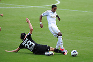 Swansea city's Scott Sinclair is tackled by Stuttgart's Tim Hoogland. Pre-season friendly match, Swansea city v FC Stuttgart at the Liberty Stadium in Swansea, South Wales on Saturday 11th August 2012. pic by Andrew Orchard, Andrew Orchard sports photography,