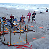 Volunteers watch over a Sea Turtle nest in Carolina Beach, N.C. (Jason A. Frizzelle)