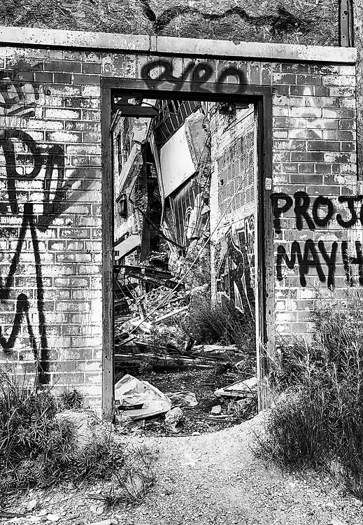 DETROIT, USA - JUNE 12, 2015: A graffiti painted doorway at the old Fisher Body Works Factory shows some of the decayed remains of the old automotive factory.