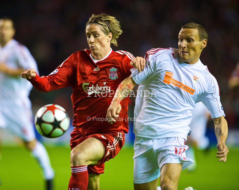 LIVERPOOL, ENGLAND - Wednesday, September 16, 2009: Liverpool's Fernando Torres and Debreceni's Laszlo Bodnar during the UEFA Champions League Group E match at Anfield. (Photo by David Rawcliffe/Propaganda)