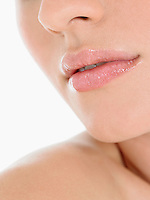 Young Woman Wearing Pink Lipstick close up of mouth