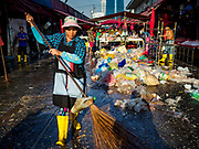"04 DECEMBER 2018 - BANGKOK, THAILAND:  Workers clean up discarded single use plastic bags in Khlong Toei market. The issue of plastic waste became a public one in early June when a whale in Thai waters died after ingesting 18 pounds of plastic. In a recent report, Ocean Conservancy claimed that Thailand, China, Indonesia, the Philippines, and Vietnam were responsible for as much as 60 percent of the plastic waste in the world's oceans. Khlong Toey (also called Khlong Toei) Market is one of the largest ""wet markets"" in Thailand. December 4 was supposed to be a plastic free day in Bangkok but many market venders continued to use plastic.   PHOTO BY JACK KURTZ"