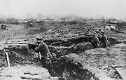 World War I 1914-1918: German soldiers entrenched on the edge of a town.