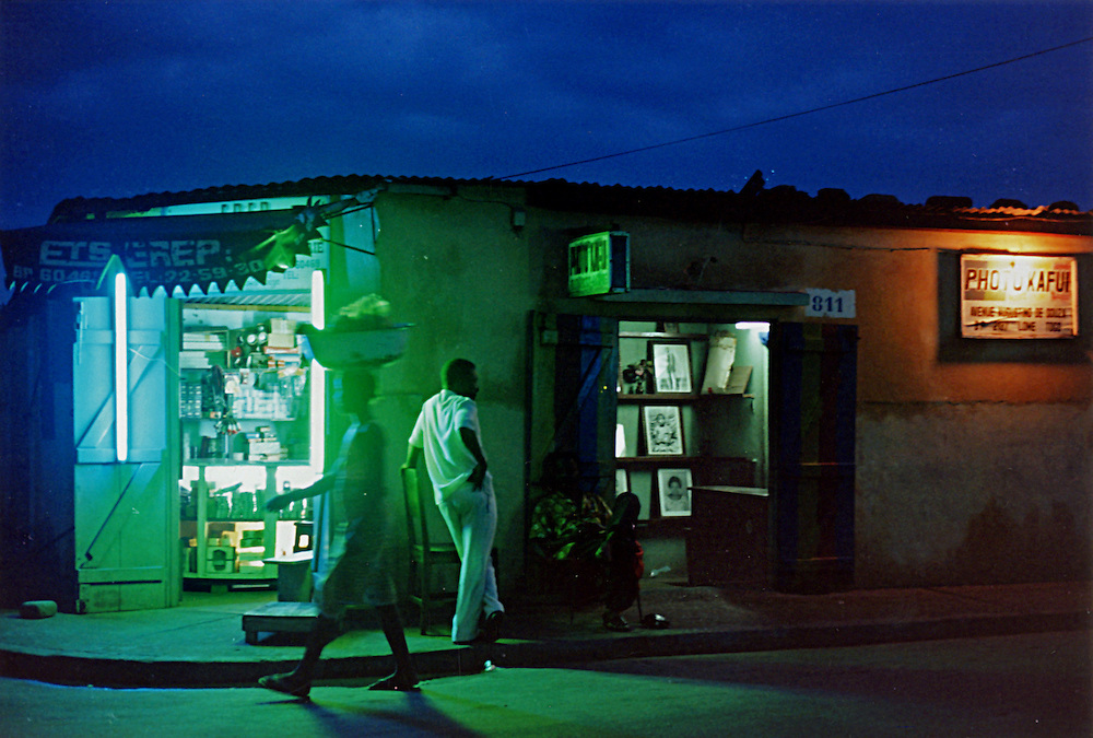 On a street, at night, in Lomé, Togo.