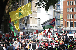 © Licensed to London News Pictures. 10/06/2018. London, UK. Hizbollah and Palenstian flags being flown at the annual Al Quds day march in support of the Palestinian cause, in central London. A counter demonstration by far-right and Zionest groups also takes place. Photo credit: Joel Goodman/LNP