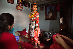 Unika Vajracharya, 6, is adorned with her ritual jewelry for the first time. In Nepal, prepubescent Newari girls known as kumaris are worshipped as deities, endowed with foreknowledge, able to cure the sick, fulfill wishes, and bestow blessings for protection and prosperity.