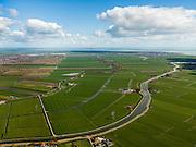 Nederland, Noord-Holland, Gemeente Waterland, 16-04-2012; zicht op polder De Purmer met de Purmerdijk en Purmerringvaart in de voorgrond. Midden links Purmerend met Purmerbos, de wijk Purmer-Noord en bedrijventerrein De Baanstee. Rechts Edam-Volendam..Polder the Purmer with its circular canal (Purmerringvaart ), left the village of Purmerend. In the back the Markermeer (lake)..luchtfoto (toeslag), aerial photo (additional fee required);.copyright foto/photo Siebe Swart