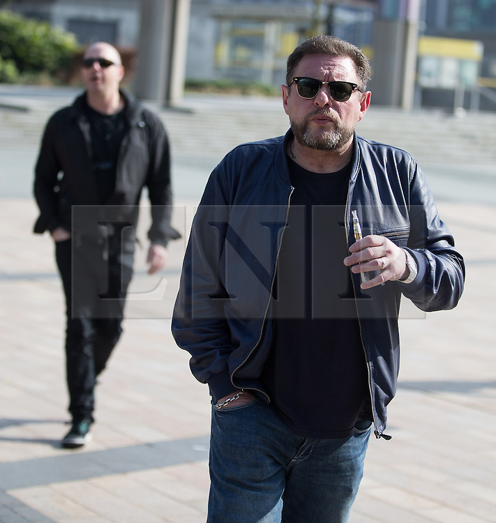 © Licensed to London News Pictures . 19/03/2015 . Salford Quays , UK . Shaun Ryder with an e-cigarette . Black Grape photocall at The Green , Salford Quays , Greater Manchester . Black Grape are reforming for a Madchester charity gig along with other local bands , to raise awareness for Bez's Reality Party and anti-fracking . Photo credit : Joel Goodman/LNP