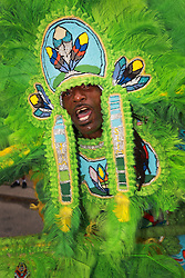29 August 2014. Lower 9th Ward, New Orleans, Louisiana. <br /> Survivors of the storm. Herbert Motton of the Hot Head Hunters leads a touching second line parade along Tennessee Street in the Lower 9th Ward in memory of those who perished in the storm 9 years ago. <br /> Photo; Charlie Varley/varleypix.com