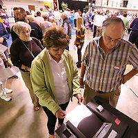 Adam Robison | BUY AT PHOTOS.DJOURNAL.COM<br /> Sherry Carr, of Tupelo, places her vote into the machine with help of poll worker Kevin West at Bissell Tuesday moring.