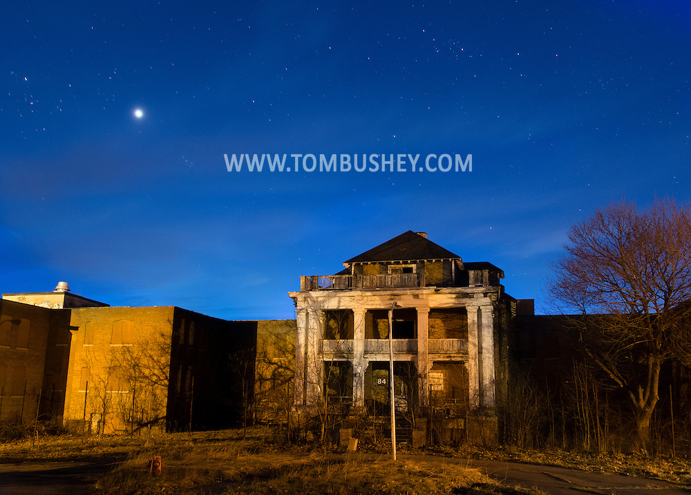 Stars and the planet Venus, at left, shine over an abandoned building at the former Middletown Psychiatric Center on April 15, 2015 in Middletown, New York.