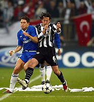 Photograph: Scott Heavey.<br />Besiktas v Chelsea. UEFA Champions league Group G. 09/12/2003.<br />Frank Lampard goes shoulder to shoulder with Yasin Sulun.
