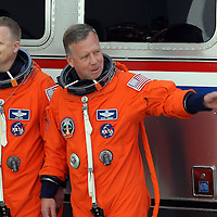 Space shuttle Discovery pilot Eric Boe, and commander Steve Lindsey, leave the Operations and Checkout Building to be transported to Pad 39A to prepare for launch at the Kennedy Space Center in Cape Canaveral, Fla., Thursday, Feb. 24, 2011. (AP Photo/Alex Menendez)