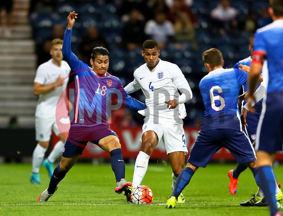 Mario Rodriguez of USA U23 tackles Ruben Loftus-Cheek of England U21  - Mandatory byline: Matt McNulty/JMP - 07966386802 - 03/09/2015 - FOOTBALL - Deepdale Stadium -Preston,England - England U21 v USA U23 - U21 International