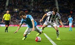 WEST BROMWICH, ENGLAND - Monday, August 10, 2015: Manchester City's David Silva in action against West Bromwich Albion's Claudio Yacob during the Premier League match at the Hawthorns. (Pic by David Rawcliffe/Propaganda)