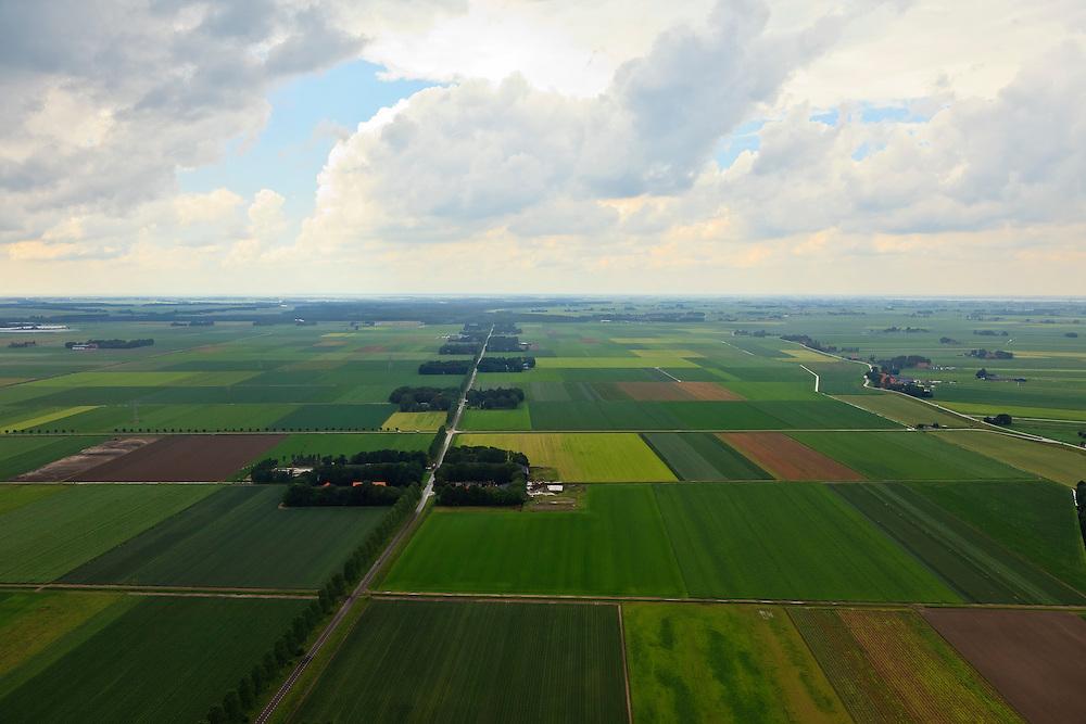 Nederland, Noordoostpolder, 30-06-2011; Uiterdijkenweg (ten noordoosten van Luttelgeest). De Noordoostpolder (NOP), is een voorbeeld van moderne grootschalige polder met rationele verkaveling. De aanleg van de polder maakte  deel uit van de Zuiderzeewerken (plan Lely) en viel in 1942 droog. De meeste boerderijen (en dorpen) zijn van na de tweede wereldoorlog..The northeast polder (NOP), is an example of modern large-scale polder with rational allotment. The construction of the polder was part of the Zuiderzee Works (Lely plan), in 1942 the polder was dry. Most of the building, farmhouses and villages, is post-war..luchtfoto (toeslag), aerial photo (additional fee required).copyright foto/photo Siebe Swart