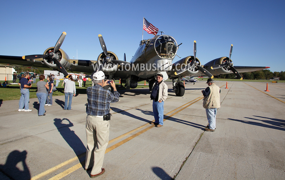 Montgomery, New York -  People look at and take photographs in front of a B-17 Flying Fortress Bomber from Collings Foundation on display as part of the Wings of Freedom Tour at Orange County Airport on Oct. 2, 2010.
