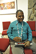 "John Gardner, a vision impaired photographer, wearing necklace he made, at Artist Reception for Seeing with Photography Collective SWPC, a group of visually impaired, sighted and totally blind photographers based in NYC, on Saturday, April 28, 2012, at African American Museum, Hempstead, New York, USA, and hosted by Long Island Center of Photography. Aperture published the group's ""Shooting Blind: Photographs by the Visually Impaired"" in 2005."