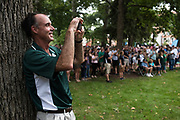 AUGUST 26, 2018  ATHENS, OHIO:<br /> Dr. Ken Johnson, Dean of the Ohio University Heritage College of Osteopathic Medicine, uses his cell phone to film the Ohio University Marching 100 as they play for a crowd on College Green after the freshman convocation at Ohio University on August 26, 2018 in Athens, Ohio.