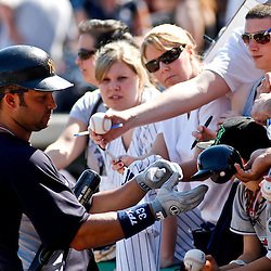 February 27, 2011; Clearwater, FL, USA; New York Yankees outfielder Nick Swisher (33) signs autographs before a spring training exhibition game against the Philadelphia Phillies at  Bright House Networks Field. Mandatory Credit: Derick E. Hingle