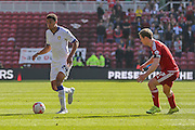 Leeds United midfielder, on loan from Cardiff City, Tom Adeyemi  watched by Middlesbrough midfielder Grant Leadbitter during the Sky Bet Championship match between Middlesbrough and Leeds United at the Riverside Stadium, Middlesbrough, England on 27 September 2015. Photo by Simon Davies.
