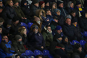 AFC Wimbledon fans with scarfs over their faces because of the cold during the EFL Sky Bet League 1 match between AFC Wimbledon and Ipswich Town at the Cherry Red Records Stadium, Kingston, England on 11 February 2020.