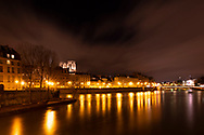 A night time view over the Seine to the Il de la Cite and Notre-Dame Cathedral.  Paris, France, Europe