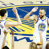 OAKLAND, CA - MAY 31: Stephen Curry #30 of the Golden State Warriors is congratulated by Klay Thompson #11 of the Golden State Warriors in Game One of the 2018 NBA Finals won 124-114 in OT by the Golden State Warriors over the Cleveland Cavaliers at the Oracle Arena on May 31, 2018 in Oakland, California. NOTE TO USER: User expressly acknowledges and agrees that, by downloading and or using this photograph, User is consenting to the terms and conditions of the Getty Images License Agreement. Mandatory Copyright Notice: Copyright 2018 NBAE (Photo by Chris Elise/NBAE via Getty Images)