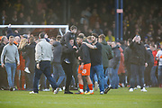 Luton Town football fans, football supporters run on the pitch, mobbing Luton Town midfielder George Moncur (20) after the EFL Sky Bet League 1 match between Luton Town and Oxford United at Kenilworth Road, Luton, England on 4 May 2019.