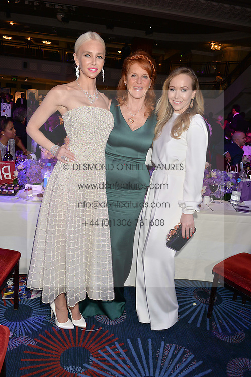 Left to right, AMANDA CRONIN, SARAH, DUCHESS OF YORK and TAMARA RALPH at The Butterfly Ball in aid of Caudwell Children held at the Grosvenor House, Park Lane, London on 25th June 2015
