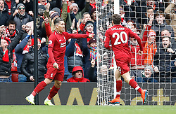 Liverpool's Roberto Firmino (left) celebrates scoring his side's first goal of the game with team-mate Adam Lallana