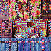 Traditional local woven textiles for sale at the market in Chichi. Chichicastenango is an indigenous Maya town in the Guatemalan highlands about 90 miles northwest of Guatemala City and at an elevation of nearly 6,500 feet. It is most famous for its markets on Sundays and Thursdays.