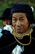 ECUADOR: Otavalo.Mother and daughter. The mother wears the traditional blueand gold beads of the proud Otavalan Indians.