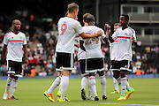 Fulham striker, Sone Aluko celebrating with team mates after scoring, 1-0 during the Pre-Season Friendly match between Fulham and Crystal Palace at Craven Cottage, London, England on 30 July 2016. Photo by Matthew Redman.