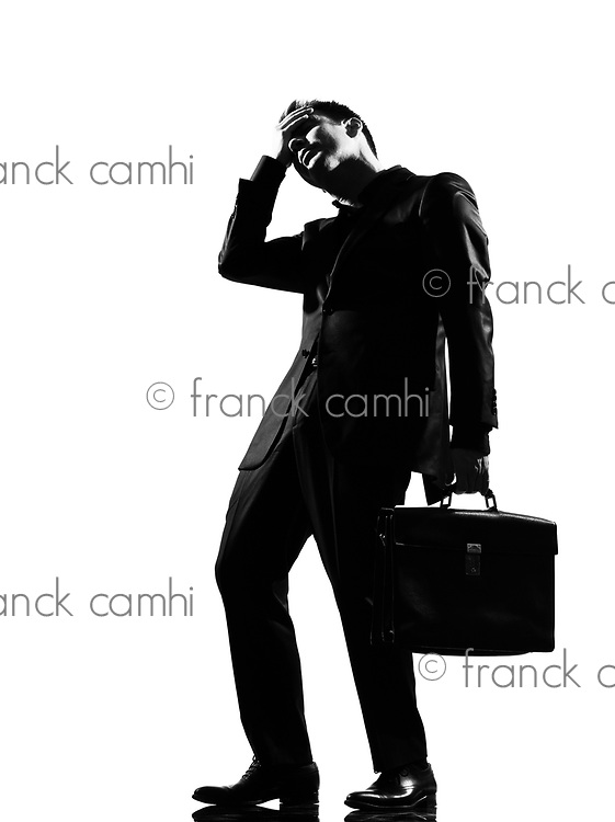 silhouette caucasian business man  expressing fatigue despair tired behavior full length on studio isolated white background