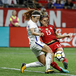 Oct 19, 2017; New Orleans, LA, USA; USA forward Alex Morgan (13) kicks a goal past Korea Republic midfielder Cho Sohyun (8) during the first half of an International Friendly Women's Soccer match at the Mercedes-Benz Superdome. Mandatory Credit: Derick E. Hingle-USA TODAY Sports
