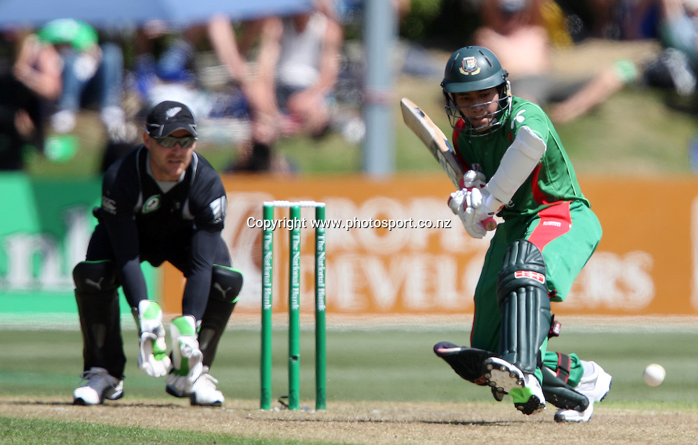Mushfiqur Rahim dances down the wicket on his way to scoring 50 runs.<br /> Cricket - 2nd ODI New Zealand Black Caps v Bangladesh, 8 February 2010, University Oval, Dunedin, New Zealand.<br /> International Cricket Season 2009/2010<br /> Photo: Rob Jefferies/PHOTOSPORT