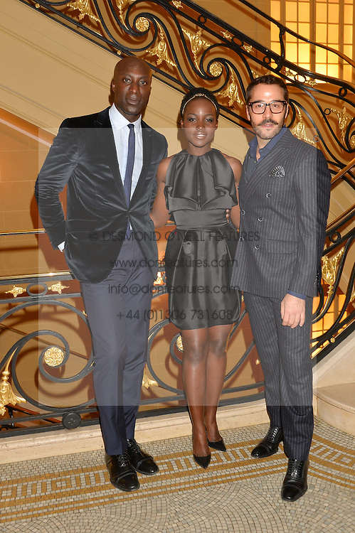 Left to right, OZWALD BOATENG, LUPITA NYONG'O and JEREMY PIVEN at the Sindika Dokolo Art Foundation Dinner held at The Cafe Royal, Regent Street, London on 18th October 2014.