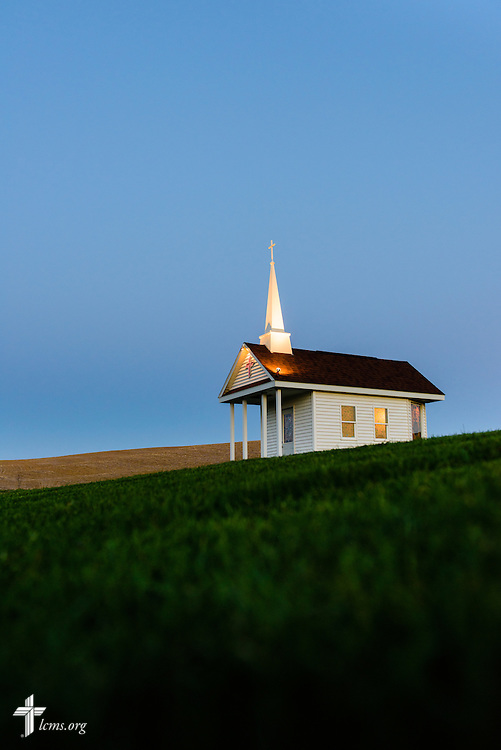 The Wayside Prayer Chapel is illuminated in the evening sky on Wednesday, April 22, 2015,  at Mission Central in Mapleton, Iowa. LCMS Communications/Erik M. Lunsford