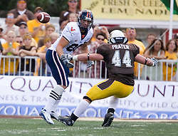 Virginia tight end Jonathan Stupar (88) misses a Virginia quarterback Jameel Sewell (10) pass.  The Wyoming Cowboys defeated the Virginia Cavaliers 23-3 at War Memorial Stadium in Laramie, WY on September 1, 2007.